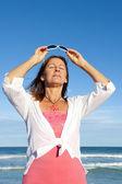 Active senior woman ocean background — Stock Photo