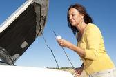 Car breakdown woman checking oil — Stock Photo