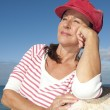Relaxed attractive mature woman outdoor — Stock Photo