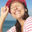 Cheerful mature woman ocean background — Stock Photo