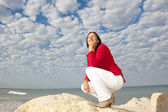 Confident mature woman ocean background — Stock Photo