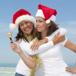 Mother daughter christmas at beach — Stock Photo