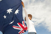 Woman with akubra hat and Australian flag — Stock fotografie