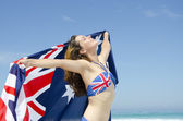 Sexy woman Australian flag at beach — Stock Photo
