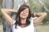Relaxed attractive mature woman portrait outdoor — Stock Photo