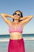 Attractive sporty mature woman ocean isolated — Stock Photo