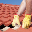 Foto Stock: Construction worker tile roofing repair