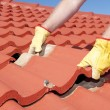 Construction worker tile roofing repair — Stock Photo #19660893
