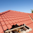 Stock Photo: Damaged red tile roof construction