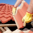 ストック写真: Construction worker tile roofing repair