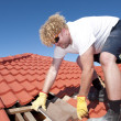 Construction worker tile roofing repairs — Stock Photo