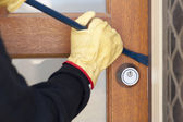 Thief breaking in house with crowbar — Stock Photo