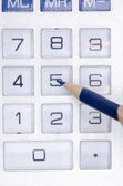 Calculator and pen adding accountant figures — Stock Photo