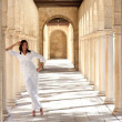 Confident happy mature woman historic archway — Stock Photo