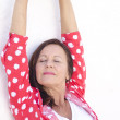 Happy relaxed mature woman white background — Stock Photo
