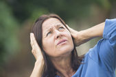 Stressed mature woman angry outdoor — Stock Photo