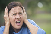 Stressed angry mature woman outdoor — Stock Photo