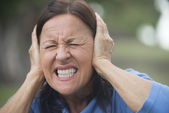 Upset stressed mature woman outdoor — Stock Photo