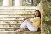 Relaxed confident mature woman outdoor — Stock Photo