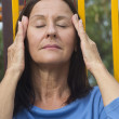 Relaxed mature woman meditating — Stock Photo