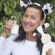 Friendly funny woman with milk and cow — Stock Photo