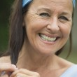 Happy relaxed attractive senior woman — Stock Photo