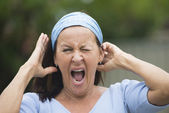 Portrait mature woman yawning stretching — Stock Photo