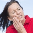 Woman suffering painful toothache — Stock Photo #30937793