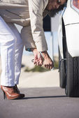 Mature Woman tyre change car break down — Stock Photo