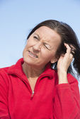 Worried concerned mature woman — Stock Photo