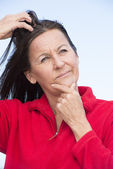 Stressed thoughtful woman scratching head — Stock Photo