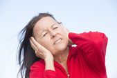 Stressed worried woman with hands on ears — Stock Photo