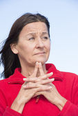 Worried mature woman outdoor — Stock Photo