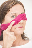 One eye blindfolded mature woman — Stock Photo