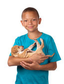 Boy cuddles puppy — Stock Photo
