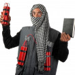 Man with bombs and manual - Stock Photo