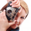 Pretty young woman with vintage camera — Stock Photo #11410908