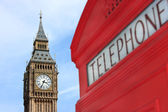 London phone box with Big Ben in background — Stock Photo
