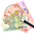 Magnifying glass on money — Stock Photo #37809245