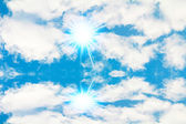 Peaceful background - bright sun, blue sky, white clouds - heave — Stock Photo
