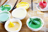Colorful paint in the bowl — Stock Photo