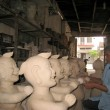 Stock Photo: Artist clay statue of msmiling