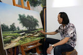 The artist is drawing landscape — Stock Photo