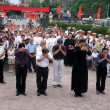 Stock Photo: Parish priests and parishioners in commemoration of those who