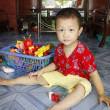 Asian boy about 1 year old, alone , playing with toys — Stock Photo