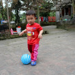 Boy play football in the yard — Stock Photo