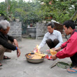 Stock Photo: Rural family burning of votive for ancestors