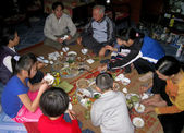 Meal in new yaer of a rural family — Stock Photo