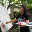Female artist painting at home — Stock Photo