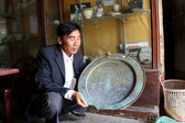 Asian man collecting antique product — Stock Photo